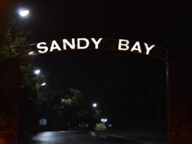 Sandy Bay sign lit up